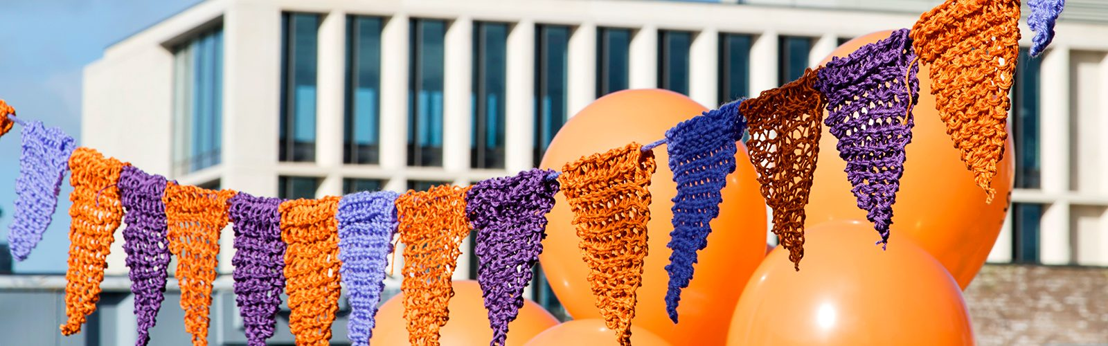 Orange and purple bunting in front of a building